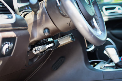 Universal magnetic holster mounted under the steering wheel