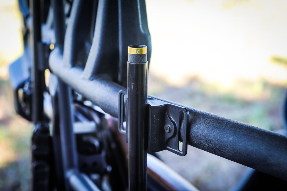 CoJo gun magnet holding the barrel of a shotgun in a UTV