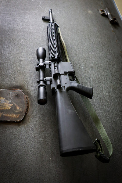 AR rifle being held by a CoJo Gun gripper on the wall of a safe.
