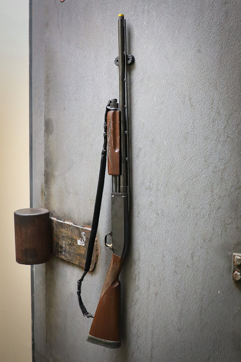 A Shotgun held to a safe door by a CoJo Gun gripper gun magnet