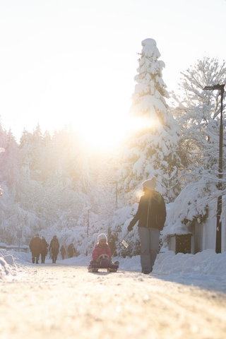 Tourists strolling during a sunny Alaskan winter day