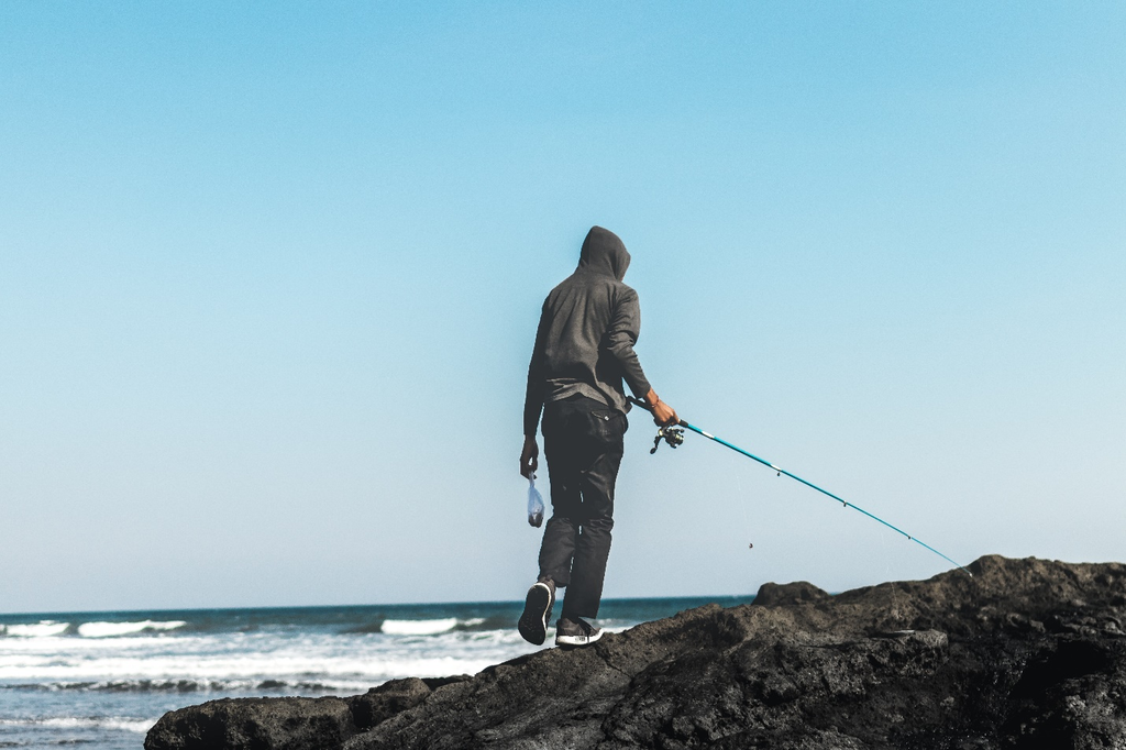 A person wears a fishing hoodie during fishing