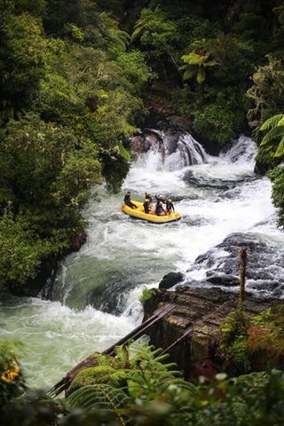 A group of people rafting