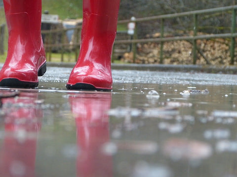 A person wearing waterproof boots