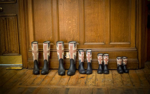 Uk Wellington Boots lined up in a hallway