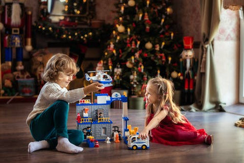 Unisex children play with christmas toys
