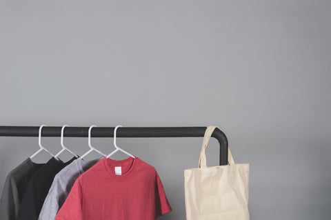 Clothes hung up on hangers on a clothes rail