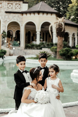 a bride and three children wearing Party Clothes