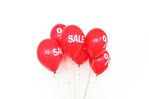 A group of red SALE balloons