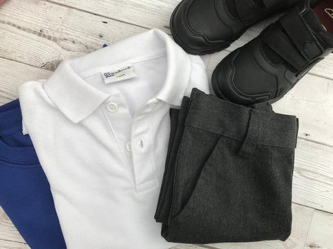 second hand school uniform laid out on a table flat