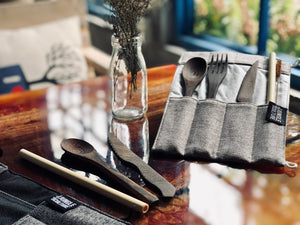 Reusable handmade dark wood cutlery set with travel utensils