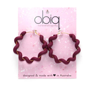 wiggly hoop style earrings plum wine colour wrapped around gold hoop