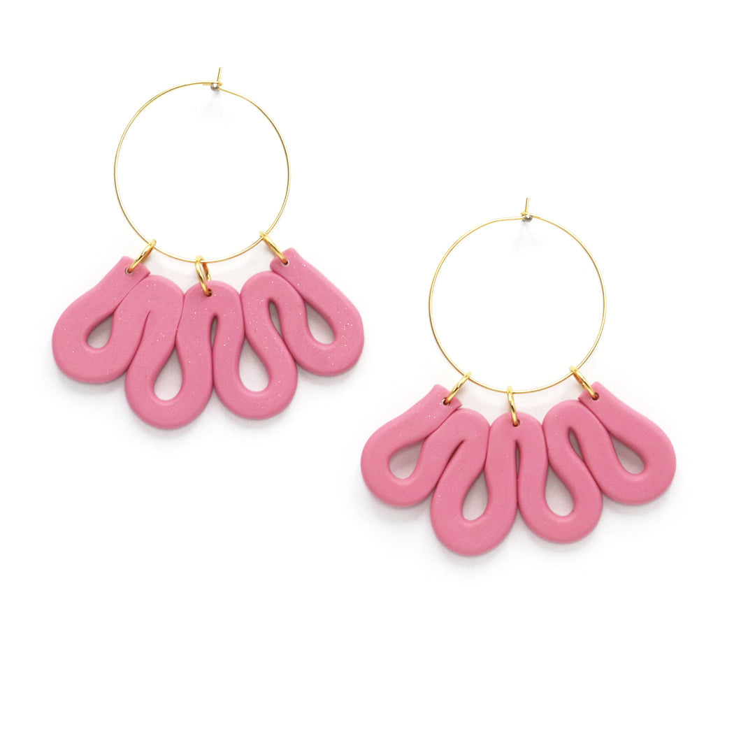Warm dusty rose with a bit of a shimmer, these statement earrings are the perfect thing to finish of an outfit