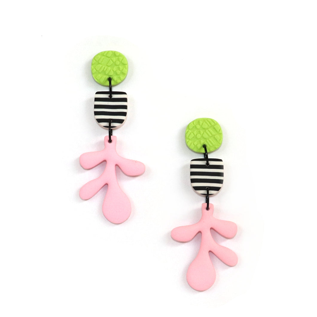 statement earrings made from polymer clay. Three components - the top is pistachio green, middle is black & white stripe & bottom component is coral shape in soft pink.