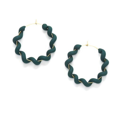 beautiful emerald green hoop earrings with soft shimmer. earrings are a wiggly hoop style