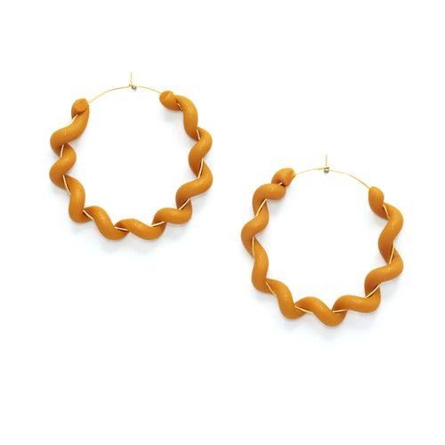 wiggly hoop earrings in rich sparkly mustard colour, made from polymer clay