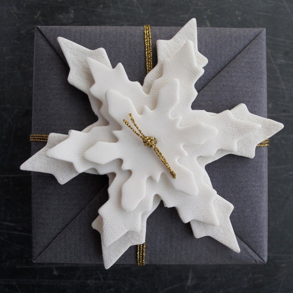 Porcelain snowflakes stacked to create a beautiful  gift wrapping detail detail