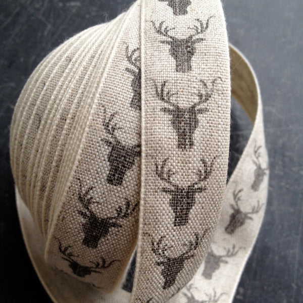 Natural Linen ribbon with charcoal stag, perfect for festive gifts, gives a highland look