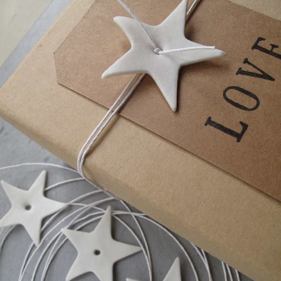 Gift stying with star and paper string