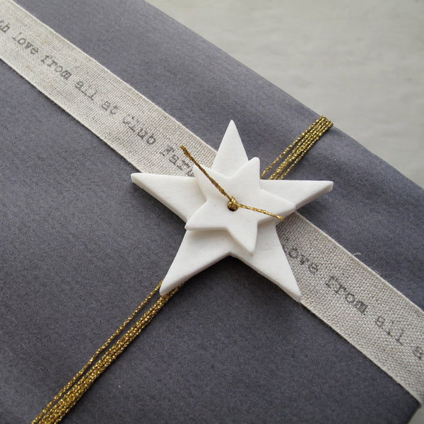 Handmade porcelain star, finishing touch for gift wrapping gifts for special occassions
