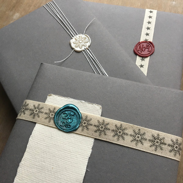 Brass wax seal stamps in festive designs