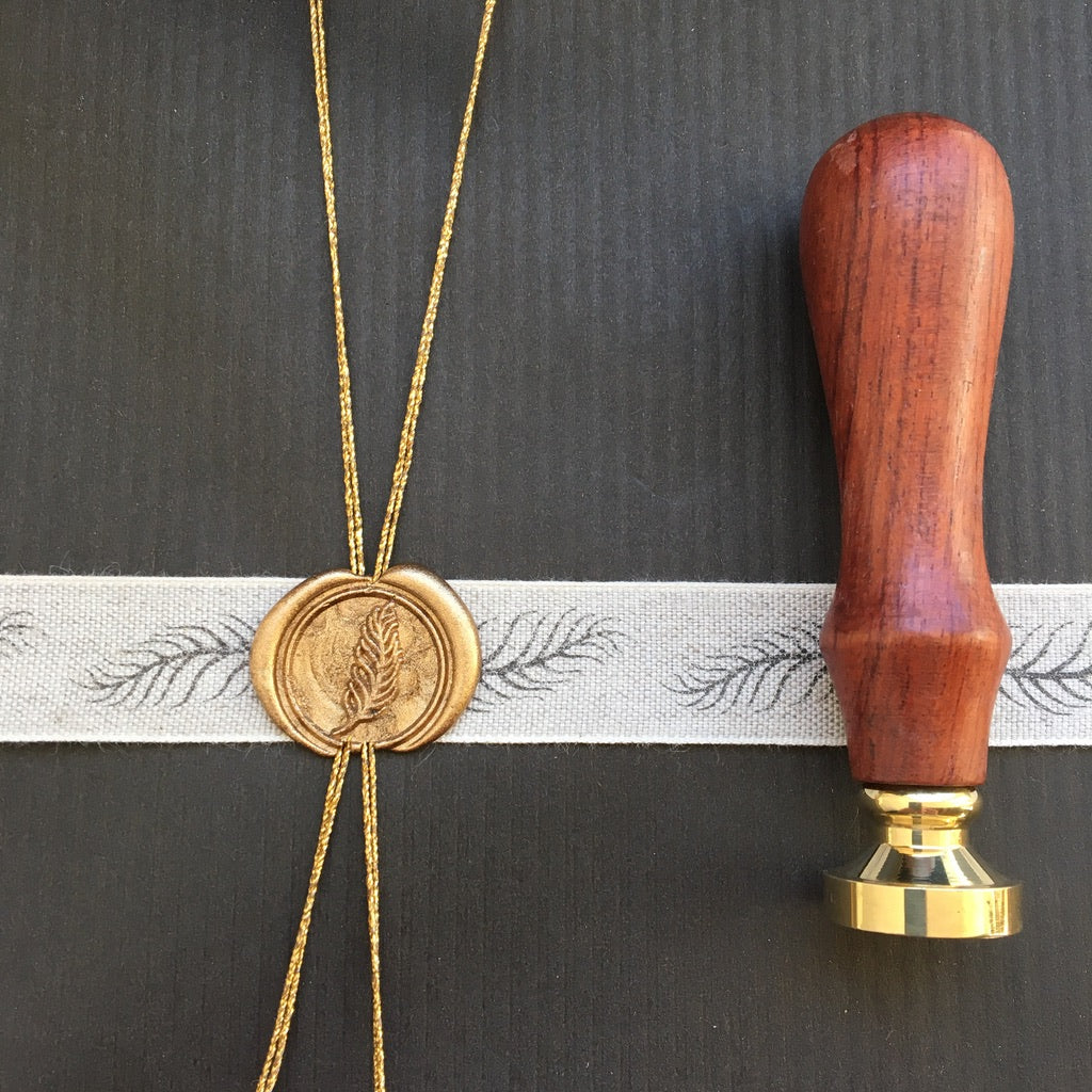 feather seal and ribbon