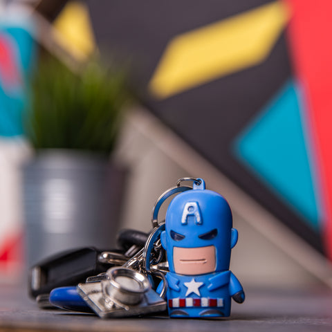 Captain America keychain figure standing in front of extremely blurred surroundings which included a custom-crafted decoration for a giftopiia gift box.