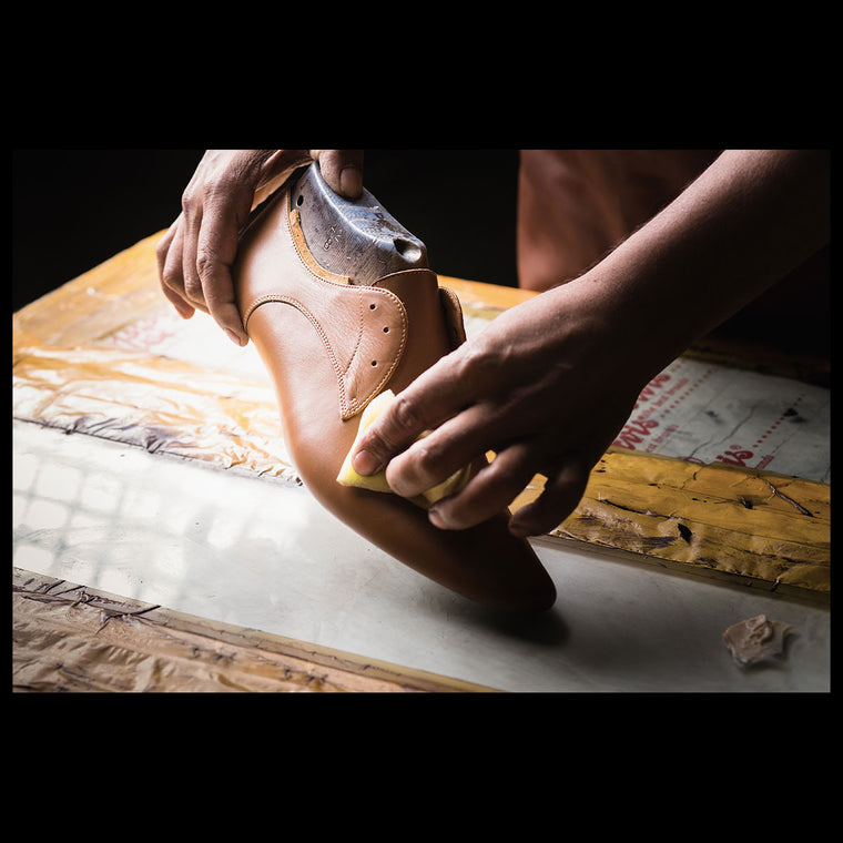 The process of hand finishing a leather shoes.