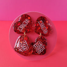 "Load image into Gallery viewer, Galentine's day Ruby Red ""Love 'em and Leave 'em"" Heart Earrings"
