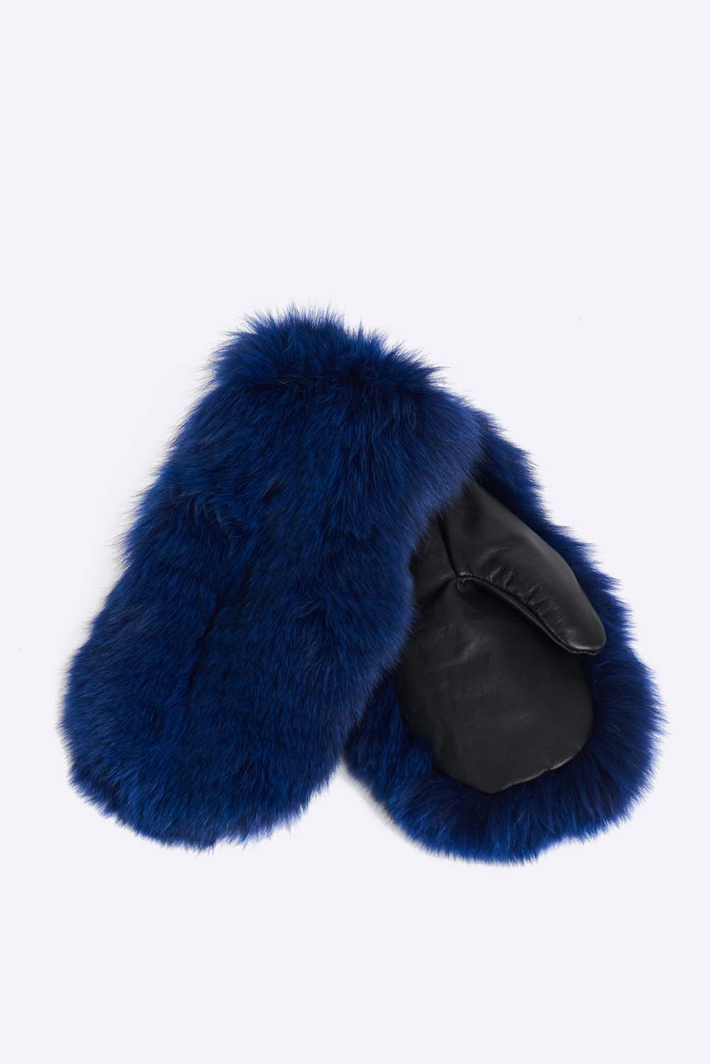 Upcycled fox fur winter mittens with a polyester lining. Will keep your hands warm in the coldest winter conditions. Has a leather trim and is cut, dyed and stitched by hand. Hand made in Montreal.