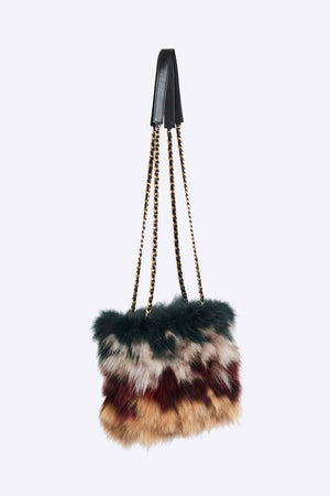 Upcycled multicolour mixed fox fur pieces purse with inner patch pocket. Polyester lining and leather trim. Hand polished zipper (Excella) with leather braided metal chain. Cut, dyed and stitched by hand as well as hand made in Montreal.