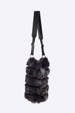 Upcycled fox fur bag with adjustable leather cross body strap. Patch pocket inside, polyester lining and leather trim. Cut, dyed and stitched by hand. Hand made in Montreal.