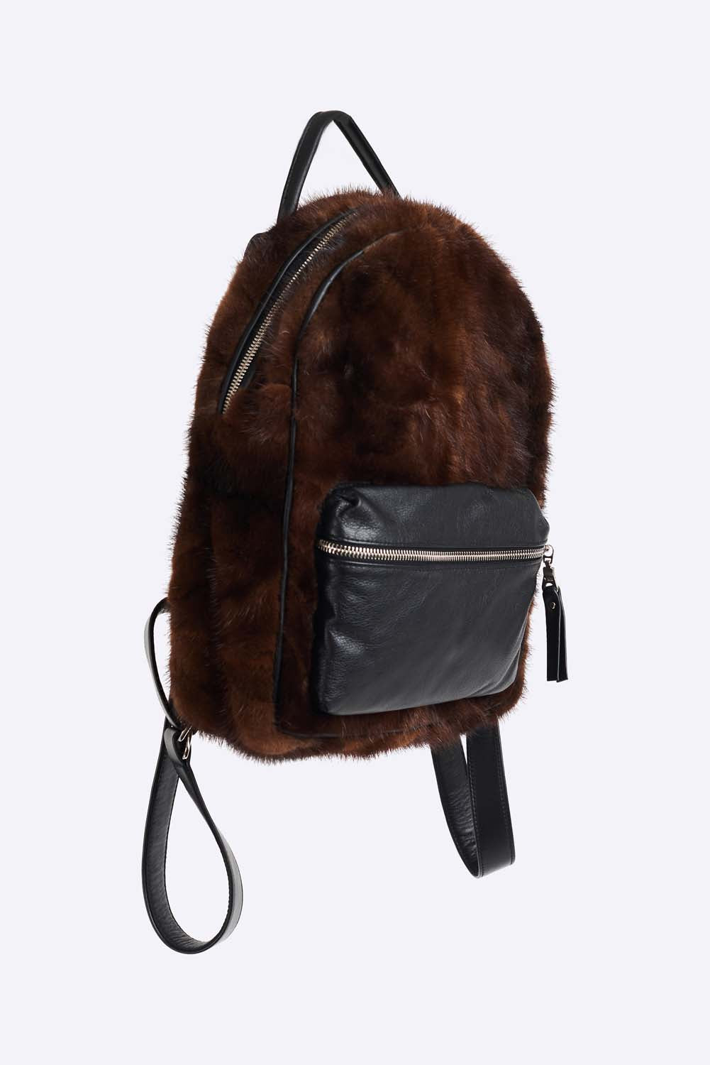Upcycled mink fur mini backpack. Front leather zip pocket and adjustable backpack straps. Single leather handle and polyester lining. Leather trim and hand polished zipper (Excella). Hand made in Montreal.