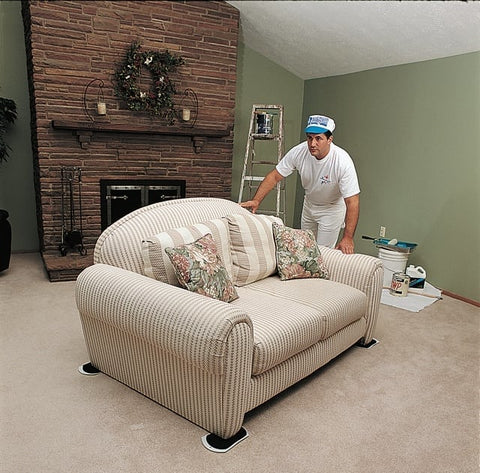 Man using EZ Move Furniture Slides to easily move heavy furniture