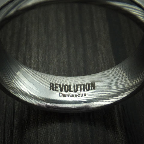 Damascus Steel Ring with Revolution Logo and Material Mark
