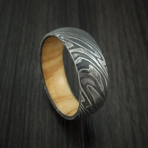 Kuro Damascus Steel Ring with Olive Wood Hardwood Sleeve Custom Made Wood Band