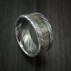 Kuro Damascus Steel ring with brown colored antler and very defined patterns