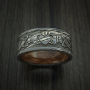 Damascus Steel Celtic Heart Ring Design with Hardwood Sleeve