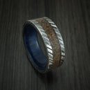 Kuro Damascus Steel Tan Dinosaur Bone Ring with Blueberry Wood Sleeve Custom Made Fossil Band