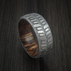 Titanium Mud Tread Tire Ring with Ziriciote Hardwood Sleeve Custom Made