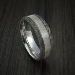 Damascus Steel ring with light colored alter and some patterns