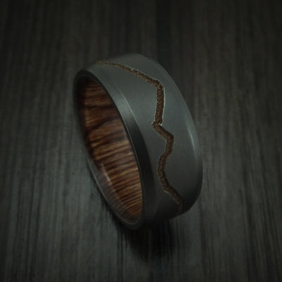 Black zirconium ring with milled mountain design and hardwood sleeve