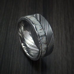 Damascus Steel ring with light colored antler and very defined patterns