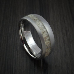 Titanium ring with tan colored antler and some patterns