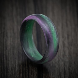 Carbon Fiber Ring with Purple and Green Glow Marbled Design
