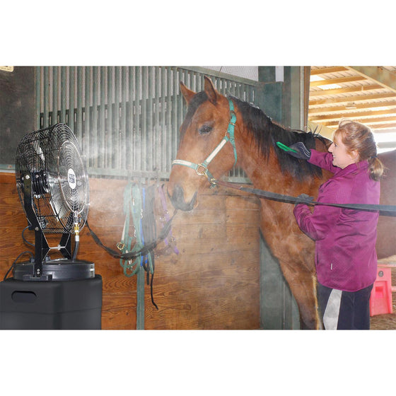 The hi-pressure misting cooling system provides comfort in the barn while a rider grooms their horse.