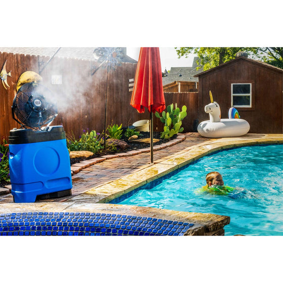 This outdoor patio fan cools a backyard on a hot summer day while children play in the pool.