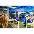 The 18 in. air cooler creates comfort outdoors under a tent as young competitors wait for the start of a stock show.