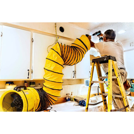 The hanger rings on the HVHF hose allow this professional contractor to effectively pull dust away from his work area in a home.