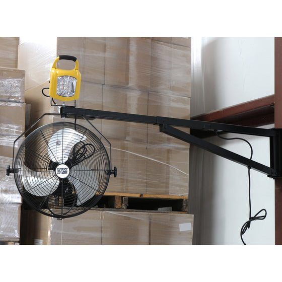 XXDOCKARM installed on wall with 18 in. wall mount fan and work light attached in a warehouse.
